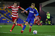 AFC Wimbledon striker Joe Pigott (39) battles for possession with Doncaster Rovers defender Tom Anderson (4) during the EFL Sky Bet League 1 match between AFC Wimbledon and Doncaster Rovers at Plough Lane, London, United Kingdom on 3 November 2020. The first League match at the new stadium.