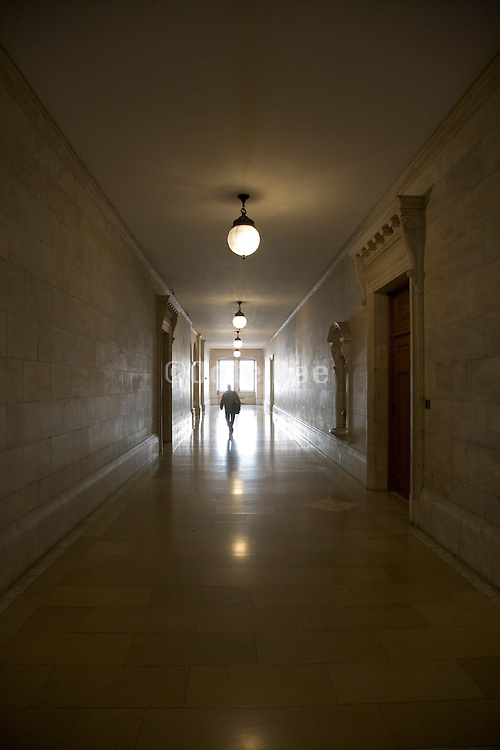 a long hall with one person walking in the distance