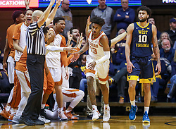 Feb 9, 2019; Morgantown, WV, USA; Texas Longhorns guard Jase Febres (13) makes a three pointer and celebrates with teammates on the bench during the second half against the West Virginia Mountaineers at WVU Coliseum. Mandatory Credit: Ben Queen-USA TODAY Sports