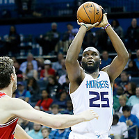 03 November 2015: Charlotte Hornets center Al Jefferson (25) takes a jump shot over Chicago Bulls forward Pau Gasol (16) during the Charlotte Hornets  130-105 victory over the Chicago Bulls, at the Time Warner Cable Arena, in Charlotte, North Carolina, USA.