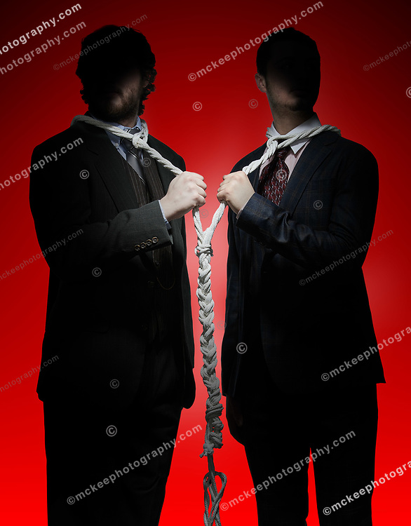 Two men in suits, silouetted on red background, with ropes around their necks, showing that we are all tied together, we are all connected. We must, indeed, all hang together or, most assuredly, we shall all hang separately. Benjamin Franklin.