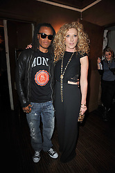 Footballer EDGAR DAVIDS and KELLY HOPPEN at a party to celebrate the publication of her new book - Kelly Hoppen: Ideas, held at Beach Blanket Babylon, 45 Ledbury Road, London W11 on 4th April 2011.