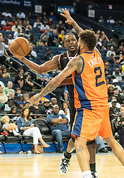 July 6, 2018 - Oakland, CA, U.S. - OAKLAND, CA - JULY 06: Al Harrington (3) co-captain of Trilogy gets ready to pass the ball around Andre Emmett (2) of 3's Company during game 1 in week three of the BIG3 3-on-3 basketball league on Friday, July 6, 2018 at the Oracle Arena in Oakland, CA  (Photo by Douglas Stringer/Icon Sportswire) (Credit Image: © Douglas Stringer/Icon SMI via ZUMA Press)
