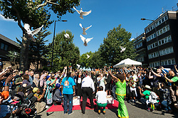 © Licensed to London News Pictures. 27/08/2017. London, UK. Doves are released at a multi-faith prayer service taking place before the start of the first day of the Notting Hill Carnival. The service was to remember victims of the Grenfell Fire disaster. It is second largest street festival in the world after the Rio Carnival in Brazil, attracting over 1 million people. Photo credit: Ray Tang/LNP