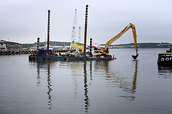 Dredging is carried out at the port entrance through which the Royal Navy's new aircraft carrier HMS Queen Elizabeth has to be manoeuvred through, at Rosyth Dockyard in Dunfermline.