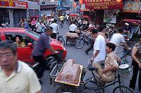 Street seller on Houhai bridge in Beijing. August 2005.