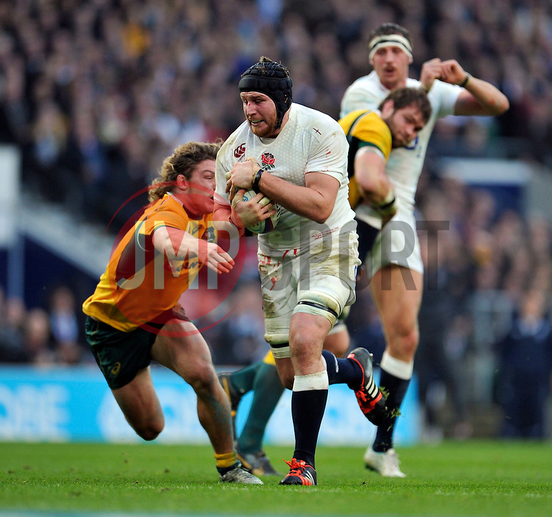Ben Morgan of England takes on the Australia defence - Photo mandatory by-line: Patrick Khachfe/JMP - Mobile: 07966 386802 29/11/2014 - SPORT - RUGBY UNION - London - Twickenham Stadium - England v Australia - QBE Internationals