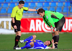 Referee Emir Huselja, Injured Bojan Matjasec (3) of Nafta and Goalkeeper Ales Luk (99) of Nafta at 12th Round of PrvaLiga Telekom Slovenije between NK Primorje vs NK Nafta Lendava, on October 5, 2008, in Town stadium in Ajdovscina. Nafta won the match 2:1. (Photo by Vid Ponikvar / Sportal Images)