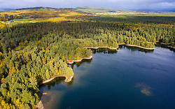 Aerial view of Loch Vaa and red boathouse  in Cairngorms National Park near Aviemore, Scottish Highlands, Scotland, UK