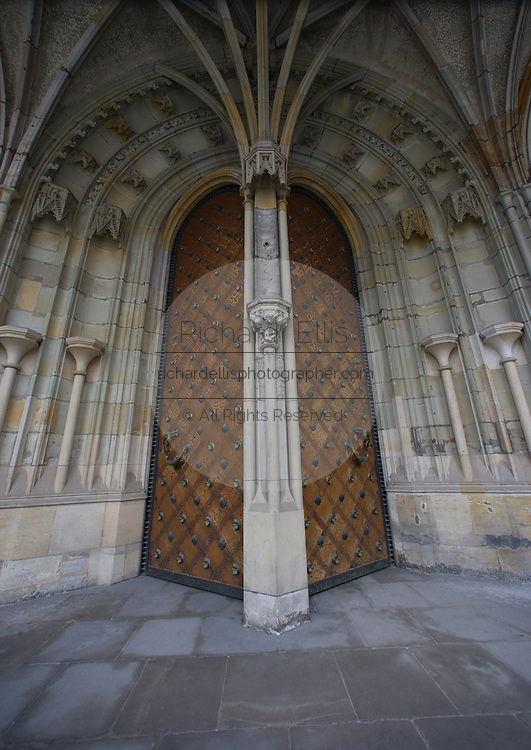 Ornately carved wooden door at St. Vitus's Catherdral Prague Castle in Prague, Czech Republic. The castle, first constructed in the 10th century is the seat of government in the Czech Republic.