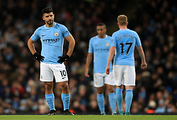 Manchester City's Sergio Aguero (left) looks dejected after seeing his side concede