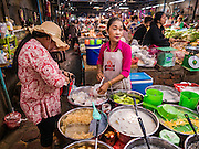 01 JUNE 2016 - SIEM REAP, CAMBODIA: A vendor sells Cambodian desserts in the Siem Reap market. There are growing concerns that spot food shortages, especially of fish, the Cambodians main source of protein, could become worse if the coming rainy season doesn't bring relief from the drought that has gripped Cambodia for the last two years.          PHOTO BY JACK KURTZ