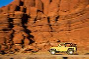 A jeep on Potash Road, Island in the Sky District, Canyonlands National Park, near Moab, Utah.