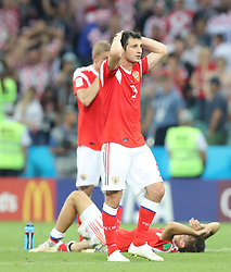 SOCHI, July 7, 2018  Alan Dzagoev (front) of Russia reacts after the 2018 FIFA World Cup quarter-final match between Russia and Croatia in Sochi, Russia, July 7, 2018. Croatia won 6-5 (4-3 in penalty shootout) and advanced to the semi-finals. (Credit Image: © Yang Lei/Xinhua via ZUMA Wire)