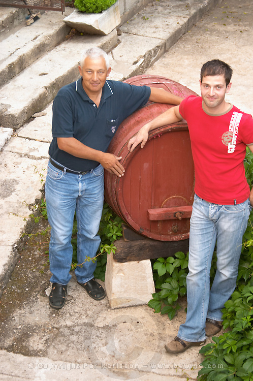 Frano and Paval Banicevic, father and son, two generations winemakers. Toreta Vinarija Winery in Smokvica village on Korcula island. Vinarija Toreta Winery, Smokvica town. Peljesac peninsula. Dalmatian Coast, Croatia, Europe.