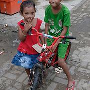 Children on the streets of Komodo. Komodo Island, Indonesia.