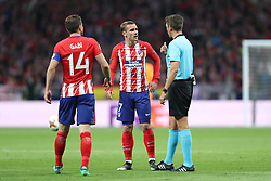 May 3, 2018 - Madrid, Spain - ANTOINE GRIEZMANN of Atletico de Madrid talks to referee GIANLUCA ROCCHI during the UEFA Europa League, semi final, 2nd leg football match between Atletico de Madrid and Arsenal FC on May 3, 2018 at Metropolitano stadium in Madrid, Spain (Credit Image: © Manuel Blondeau via ZUMA Wire)