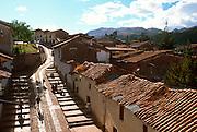 PERU, HIGHLANDS, CUZCO homes on steep hills around Cuzco