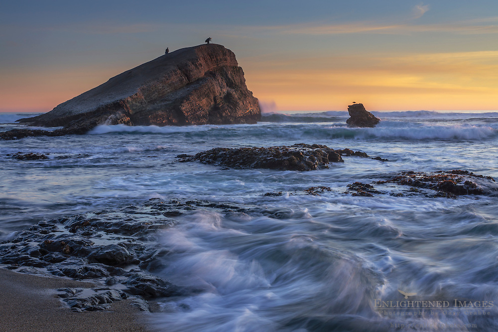 Sunset at Greyhound Rock, a tombolo sea stack, Greyhound Rock County Park, Santa Cruz County coast, California