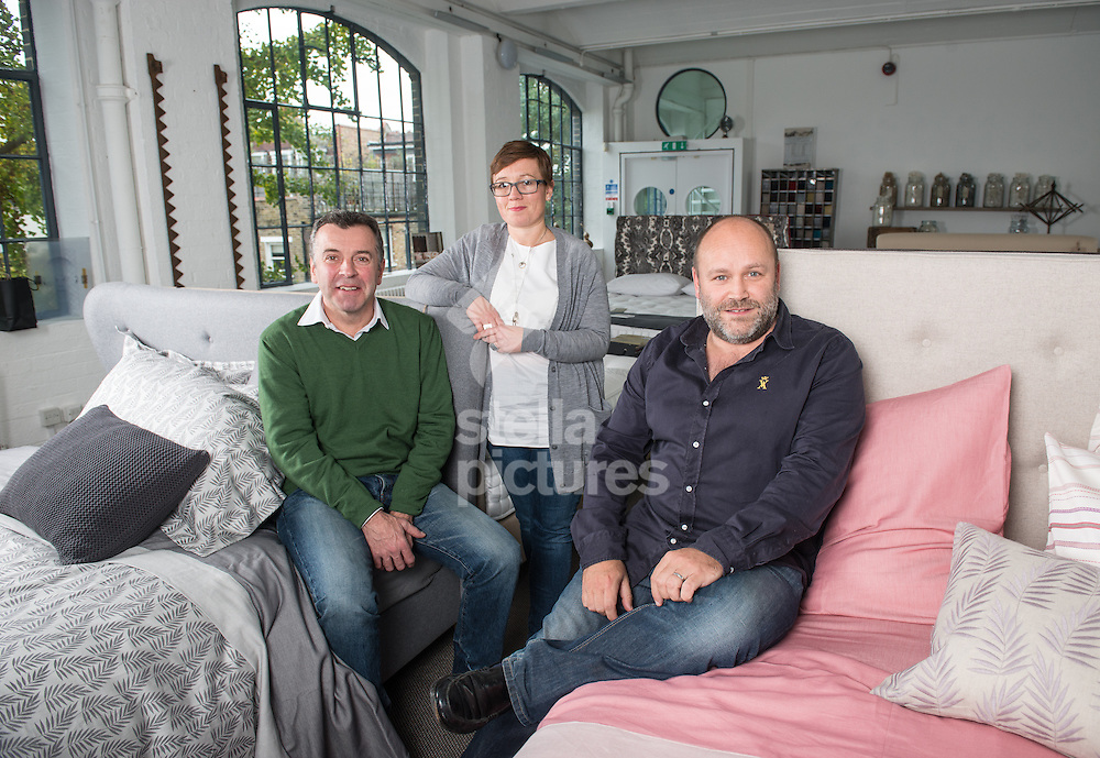 Adam Black (right) and Matthew Hardcastle from Button & Sprung with Molly Freshwater from Feather & Black pictured in their west London offices.<br /> Picture by Daniel Hambury/Stella Pictures Ltd +44 7813 022858<br /> 22/10/2014