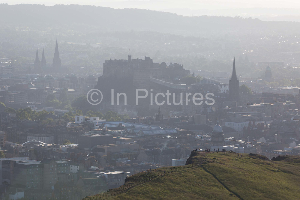 Summer evening sunshine viewpoint from Holyrood Park towards Edinburgh city and its castle, on 26th June 2019, in Edinburgh, Scotland.