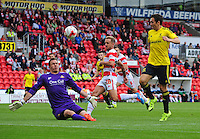 Doncaster Rovers' Thorsten Stuckmann makes a save at the feet of Middlesbrough's Stewart Downing<br /> <br /> Photographer Chris Vaughan/CameraSport<br /> <br /> Football - Pre-Season Friendly - Doncaster Rovers v Middlesbrough - Saturday 25th July 2015 - Keepmoat Stadium, Doncaster<br /> <br /> © CameraSport - 43 Linden Ave. Countesthorpe. Leicester. England. LE8 5PG - Tel: +44 (0) 116 277 4147 - admin@camerasport.com - www.camerasport.com