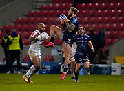 Sale Sharks wing Byron McGuigan catches a high ball under pressure from Exeter Chiefs wing Tom O'Flaherty during a Gallagher Premiership Round 11 Rugby Union match, Friday, Feb 26, 2021, in Eccles, United Kingdom. (Steve Flynn/Image of Sport)