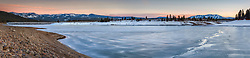 """""""Frozen Prosser Reservoir Sunset 7"""" - Stitched panoramic photograph of a sunset and a crack in the ice at a frozen over Prosser Reservoir in Truckee, California. Northstar Ski Resort can be seen in the distance on the right."""