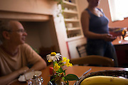 Mealtime for visitors in dining room at the Rivendell Buddhist Retreat Centre, East Sussex, England.