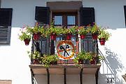 Basque house with NO CUTS banner in Erratzu in Valle de Baztan, Basque Country, Spain