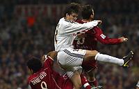 4/2/2004 Madrid, Spain.<br />Copa Del Rey (Spanish Cup) Semifinals. 1 Leg.<br />R.Madrid 2 - Sevilla 0<br />R.Madrid's Solari (C) in duel with Sevilla's Redondo (R) and Daniel Alves (R.D) at Santiago Bernabeu's Stadium.