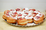 Sufganiyah a traditional Jewish Doughnut eaten during Hanukkah with red jam and sugar powder On white Background