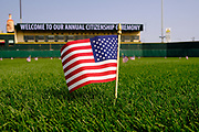 17 SEPTEMBER 2020 - DES MOINES, IOWA: An American flag marks the spot where a new citizen will stand before a naturalization ceremony at Principal Park, a minor league baseball stadium in downtown Des Moines. About 75 people from 32 countries were naturalized as US citizens Thursday. It was the last citizenship ceremony in Des Moines before citizenship fees dramatically increase. Starting Oct. 2, the fee to apply for U.S. citizenship will increase from $640 to $1,160 if filed online, or $ 1,170 in paper filing, a more than 80% increase in cost. Advocates for immigration are afraid the new fees will be too expensive for many immigrants and say it's an effort by the Trump Administration to limit the number of new citizens welcomed into the United States. Because of the COVID-19 pandemic, there has been dramatic slow down in the number of naturalization ceremonies this year.    PHOTO BY JACK KURTZ