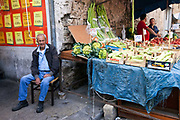 An old man at his vegetable stall in the Capo Market, Palermo, Italy
