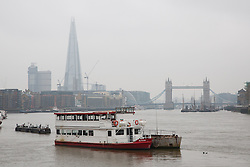 © Licensed to London News Pictures. 04/04/2014. London, UK. Smog continues to shroud the London Shard and Tower Bridge on the River Thames this morning, 4th April 2014. Weather forecasters predict pollution levels have peaked in London and that a westerly wind today will start to blow the smog away into the North Sea and clear the air. Photo credit : Vickie Flores/LNP