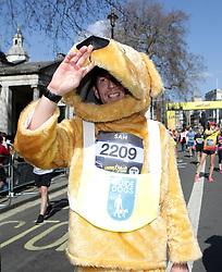 Competitors in fancy dress cross the finish line during the 2019 London Landmarks Half Marathon.