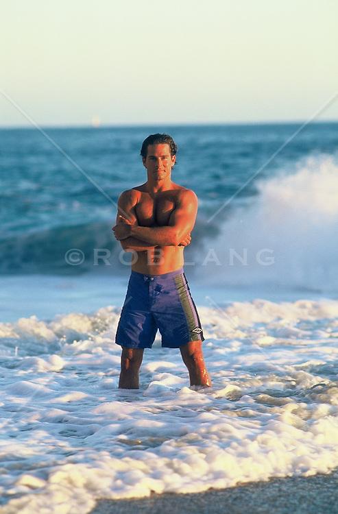 Good looking man standing in the ocean