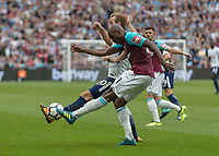 Football - 2017 / 2018 Premier League - West Ham United vs Tottenham Hotspur<br /> <br /> Harry Kane (Tottenham FC)  tries to block the clearance of Angelo Ogbonna (West Ham United) at the London Stadium<br /> <br /> COLORSPORT/DANIEL BEARHAM