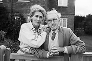 Two of the esteemed veteran photojournalists from the era of the weekly Picture Post magazine, Grace Robertson and Thurston Hopkins are is seen at the front gate of their home in East Sussex. Robertson was born in 1930 and Hopkins in 1913 and both worked under editor (Sir) Tom Hopkinson on the prominent photojournalistic magazine published in the United Kingdom from 1938 to 1957. It is considered a pioneering example of photojournalism and was an immediate success, selling 1,600,000 copies a week after only six months. It has been called the Life magazine of the United Kingdom..