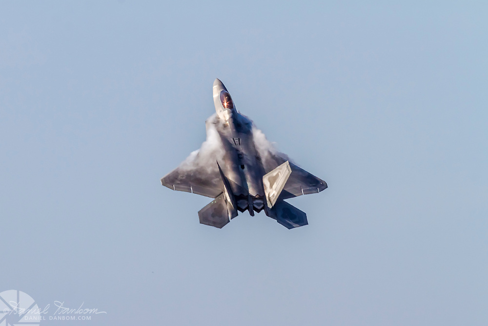 F-22 Raptor in steep climb with mist forming on the wings, MRY, Monterey, California