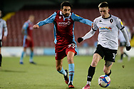 Scunthorpe United Jem Karacan (23) Salford City Ashley Hunter (10) battles for possession during the EFL Sky Bet League 2 match between Scunthorpe United and Salford City at the Sands Venue Stadium, Scunthorpe, England on 12 January 2021.