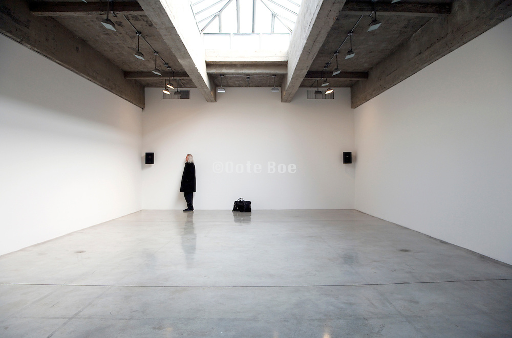 person listening to a sound installation in the Tanya Bonakdar Gallery
