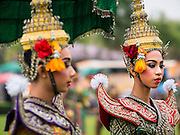 10 JANUARY 2015 - BANGKOK, THAILAND: Traditional Thai Khon dancers, on the lawn of Government House  during Children's Day festivities in Bangkok. National Children's Day falls on the second Saturday of the year. Thai government agencies sponsor child friendly events and the military usually opens army bases to children, who come to play on tanks and artillery pieces. This year Thai Prime Minister General Prayuth Chan-ocha, hosted several events at Government House, the Prime Minister's office.    PHOTO BY JACK KURTZ