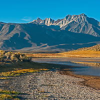 Mount Baldwin, The White Fang, Mount Morrison and Laurel Mountain of the Eastern Sierra Nevada crest tower above Big Alkali Lake and Long Valley near Mammoth Lakes, California.