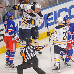Buffalo Sabres right wing Travis Turnbull (65) celebrates his goal, scored after it deflected off New York Rangers center John Mitchell's (34) skate, with Buffalo Sabres left wing Cody McCormick (8) and right wing Brad Boyes (22) during second period NHL action between the Buffalo Sabres and the New York Rangers at Madison Square Garden in New York, N.Y. The Sabres defeated the Rangers 4-1.