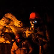 January 25, 2014 - Kiev, Ukraine: Anti-government protestors take guard a beside a fire at the barricades set up days before outside Dynamo Kiev's stadium in Kiev. (Paulo Nunes dos Santos)