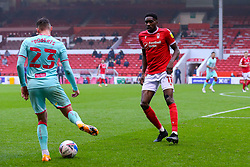 Sammy Ameobi of Nottingham Forest prevents the progress of Connor Roberts of Swansea City  - Mandatory by-line: Nick Browning/JMP - 29/11/2020 - FOOTBALL - The City Ground - Nottingham, England - Nottingham Forest v Swansea City - Sky Bet Championship
