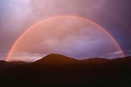 Full rainbow over Cerro Pino at sunset, Jemez Mountains, NM, © David A. Ponton