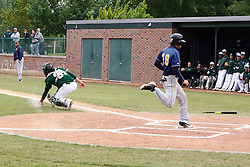 28 April 2012:  Jacob VanDuyne crosses the plate during an NCAA division 3 Baseball game between the Augustana Vikings and the Illinois Wesleyan Titans in Jack Horenberger Stadium, Bloomington IL