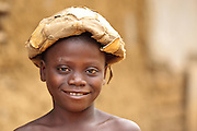 Portrait of a boy with a deflated football on his head in the village of Kawejah, Grand Cape Mount county, Liberia on Friday April 6, 2012.